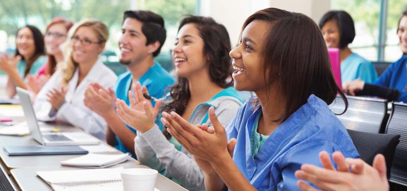 Classroom of Nurses Clapping Together